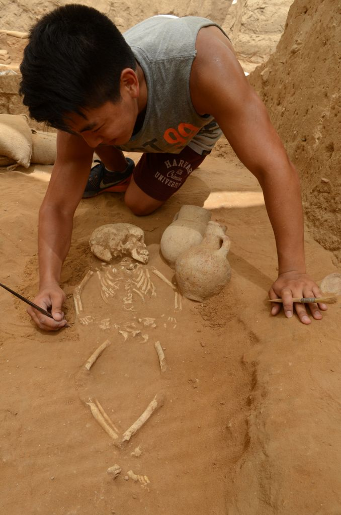 A student excavates a 10th-9th century BC burial in the excavation of the Philistine cemetery