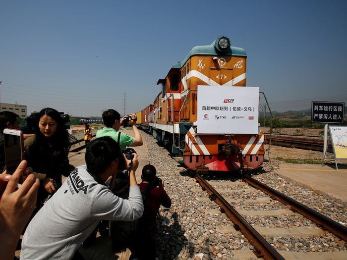 "A train carrying containers from London arrives in Yiwu, China, in April 2017. The sign at the front of the train reads: ""First Sino-Euro Freight Train (London Yiwu)."" Thomas Peter/Reuters"